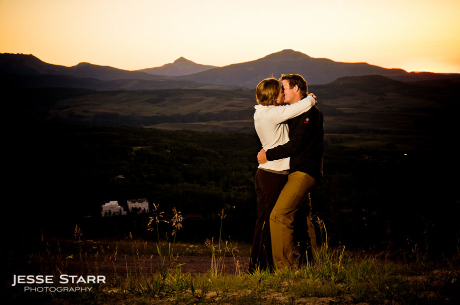 Guy and girl kissing in front of sunset in Telluride Colorado