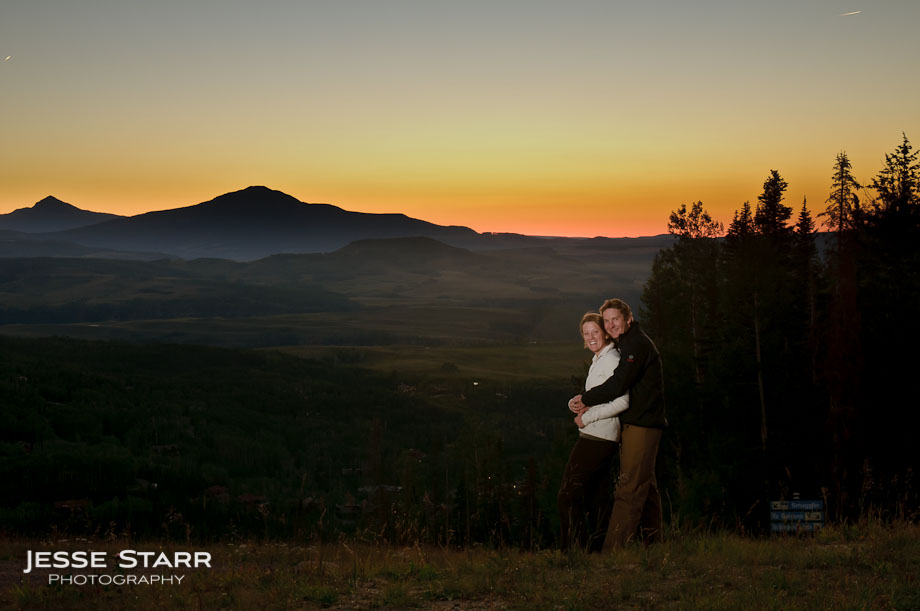 Guy holding girl in front of sunset in Telluride Colorado