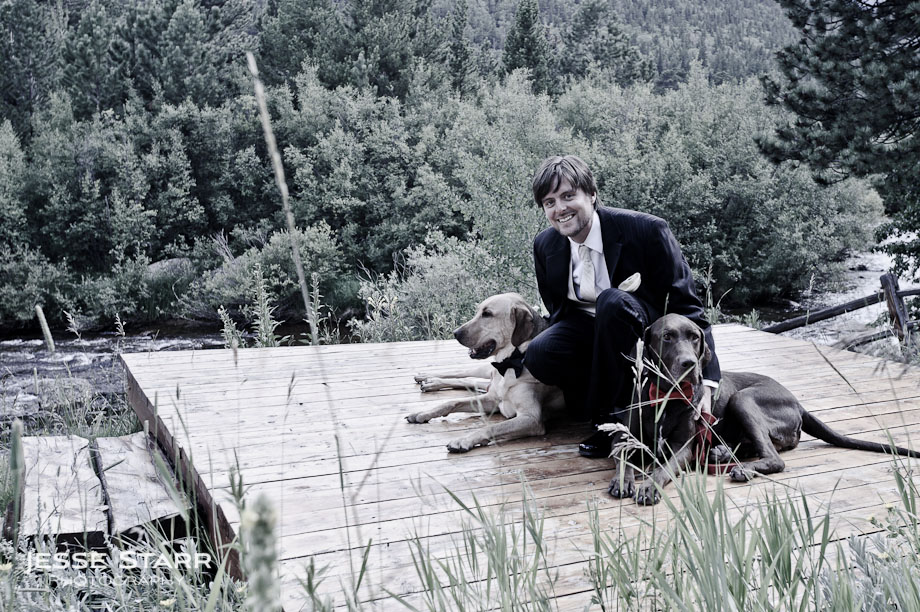 A groom and his dogs sitting at Wild Basin Lodge in Roosevelt National Forest Colorado