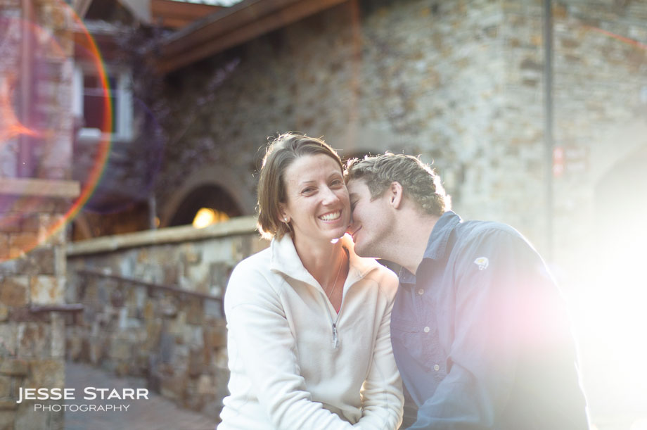 Guy kissing girl on neck engagement portrait in Telluride Colorado