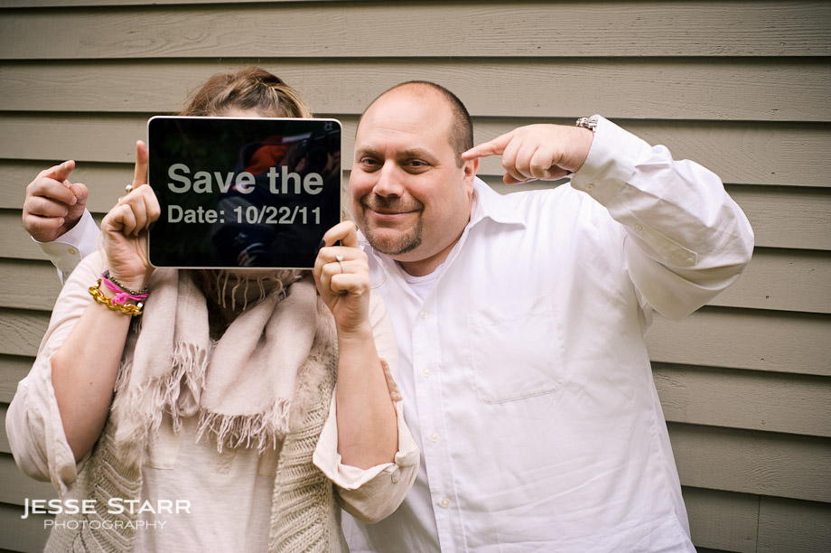 Engagement portrait with iPad save the date