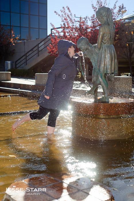 Girl drinking from water hose in Lululemon Pinnacle Jacket