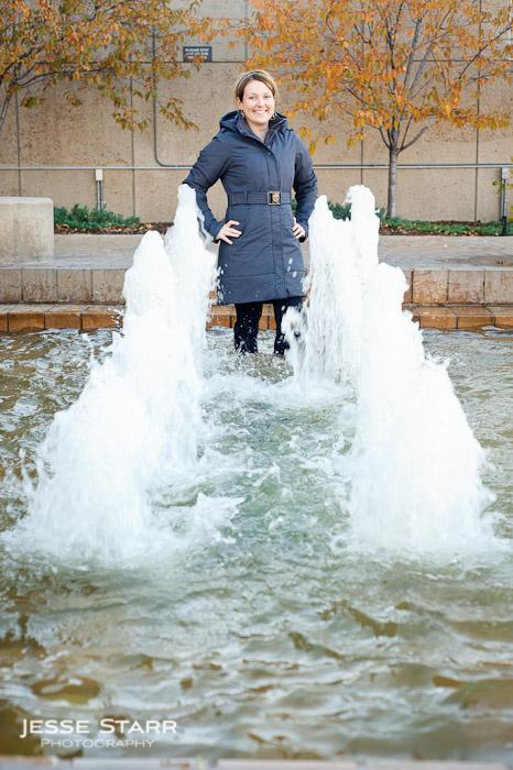 Girl standing in fountains in Lululemon Pinnacle Jacket
