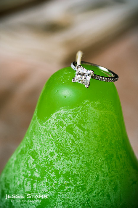 Engagement ring on apple candle