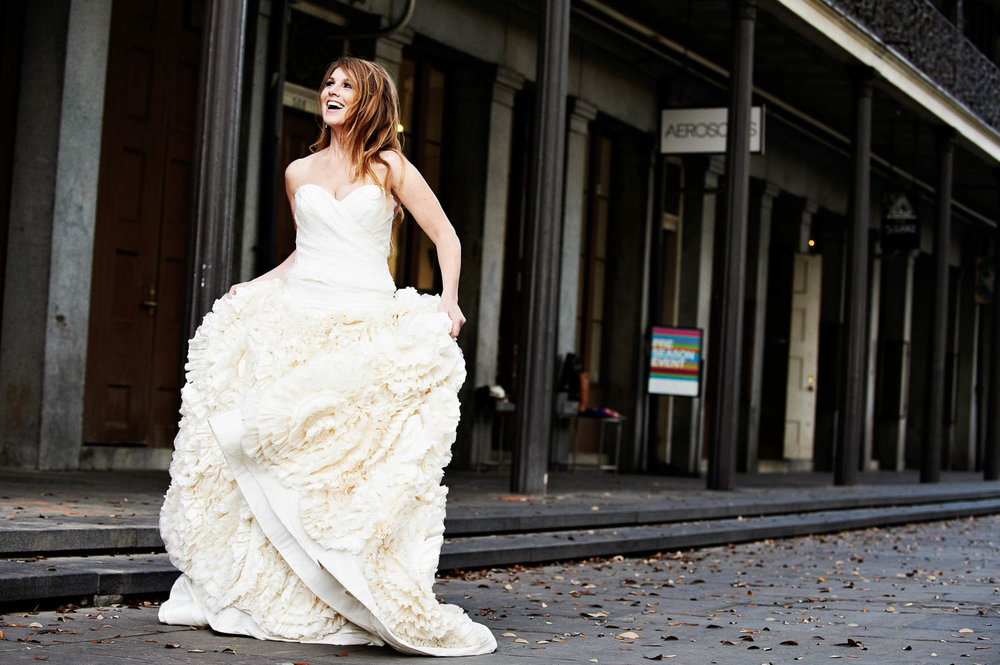 Exuberant bride in New Orleans street