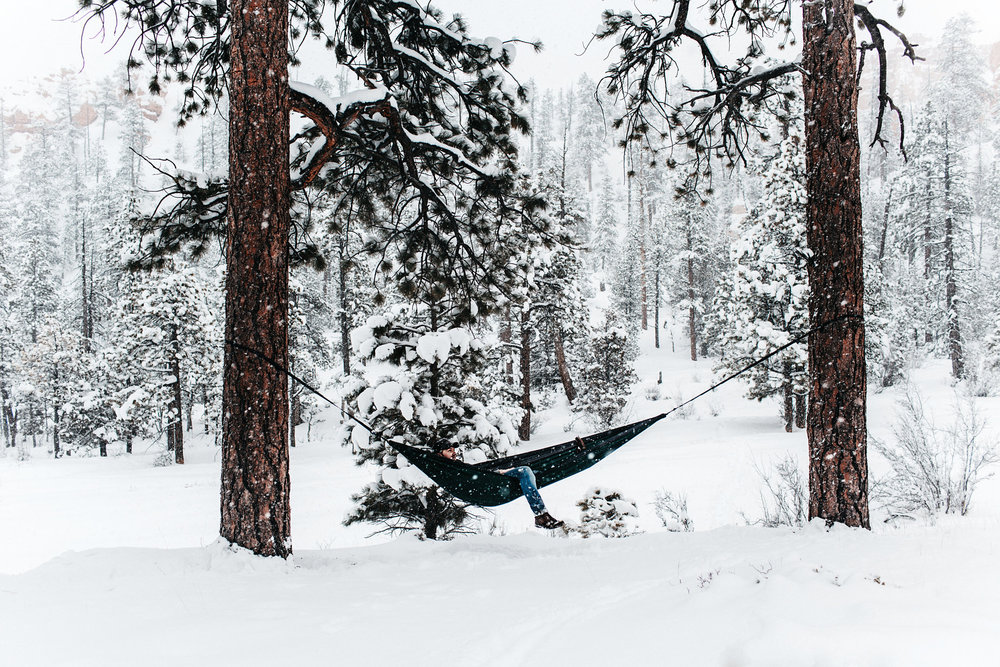 During a spring snow storm, Joshua and I hiked to the bottom of Bryce Canyon; we really enjoy experiencing the serenity that hiking through falling snow accompanies. To spend time enjoying the weather even more, we set up our double nested hammock in order to rest above the cold, wet ground. However, not too long after we laid down, we heard the howling of wolves echoing through the canyon. As quickly as possible, we jogged up the slick trail and out of the canyon before nightfall. It was adventure we'll never forget!