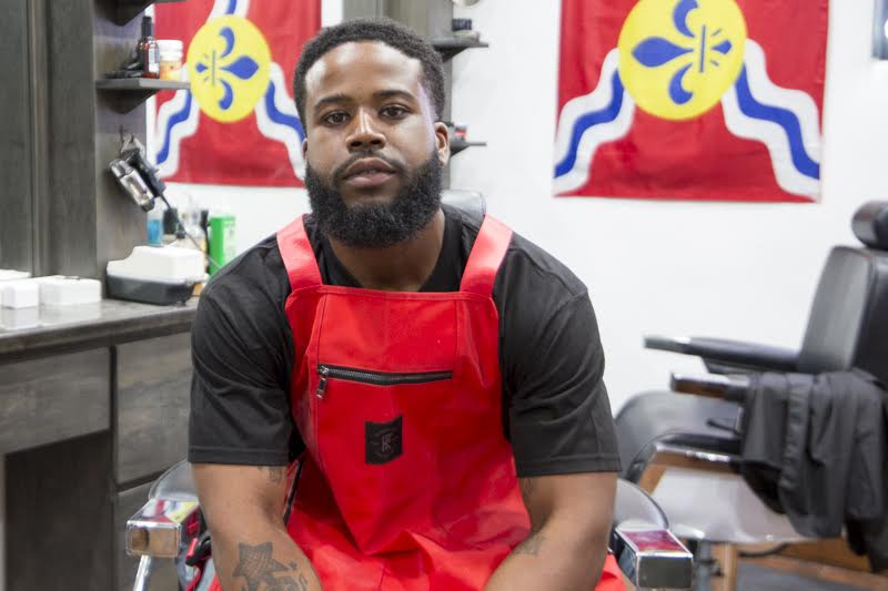 """About Your Apron - WHAT APRON ARE YOU CURRENTLY WEARING AND WHY WAS IT THE PERFECT MIX OF FORM AND FUNCTION?""""I'M CURRENTLY ROCKING THE RED NON-POROUS APRON. IT'S PERFECT FOR KEEPING HAIR FROM GETTING ALL OVER"""""""