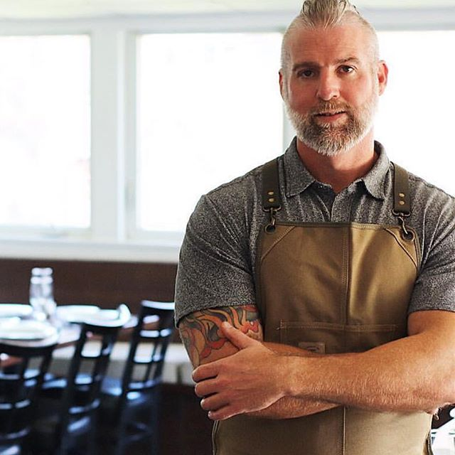 @jwilliamculinary wearing @knifeandflag 's Core Apron in Olive, also available in Denim and Black! Purchase yours by clicking the photo or link in our bio! #knifeflag #casualstyle #apronstyle #survivalunion