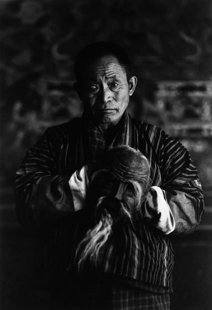 BHUATNESE MONK WEARING A MASK, AS PART OF THE 'BHUTAN' SERIES BY PHOTOGRAPHER KENRO IZU, FEATURED IN SOME/THINGS MAGAZINE CHAPTER005