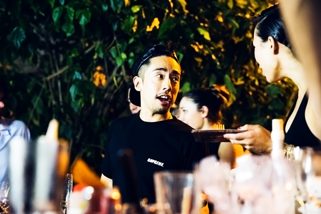 KEVIN POON OF HONG KONG STREETWEAR BRAND CLOT, WITH LINDSAY JANG OF HONG KONG RESTAURANT YARDBIRD, AT THE JOYCE WANG INTERIORS RARE TABLES COLLECTION LAUNCH EVENT IN COLLABORATION ASIA SOCIETY HONG KONG & SOME/THINGS, PHOTOGRAPHED BY ALEXEY BLAGUTIN, SOME/THINGS AGENCY