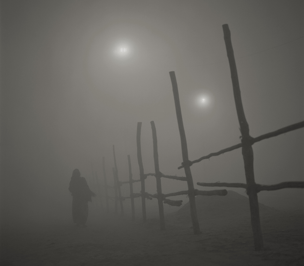 'eternal light' #8 allahabad. india 2013. in the foggy dawn, people gather for the holy bath in the confluence of river ganges and yamuna. by kenro izu
