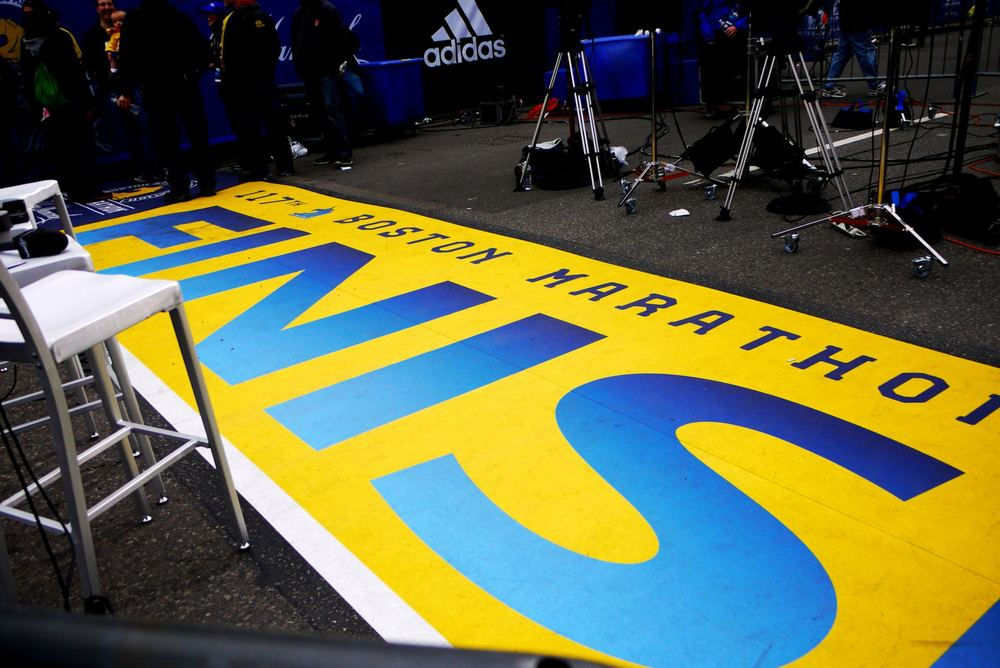 Boston Marathon 2013 |  Freshly painted finish line along Boylston Street