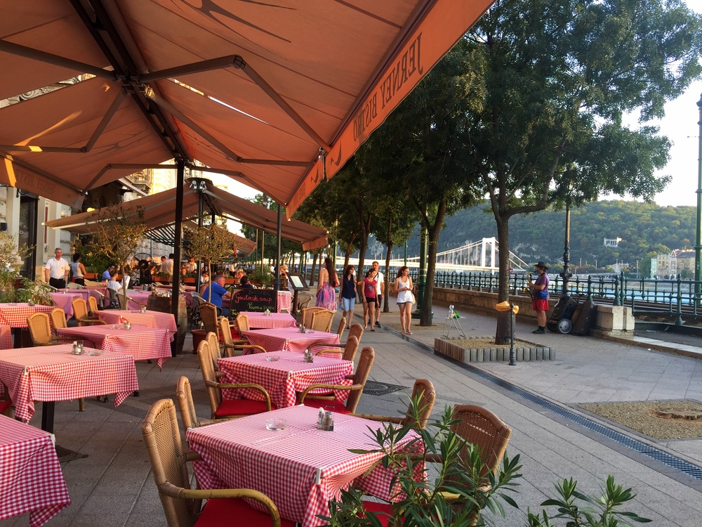 Restaurants in Pest line the eastern bank of the Danube River.