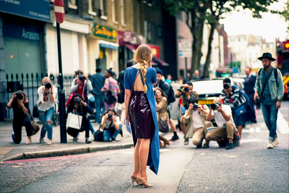 """""""Every street style photographer is a people watcher at heart. Rather than document what is on trend or what labels/designers individuals wear, what caught my attention more and dictated my choice of shots were the moments of beauty & style among the mayhem often synonymous with a fashion week."""""""