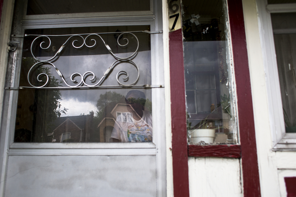 Beatrice Ford, 69, sits on the porch of her east-side Detroit home Tuesday, May 27, 2014. Ford, who's lived in the same house for 38 years, cares for her ailing 78-year-old husband, their alcoholic son and two teenage granddaughters. The family makes use of Meals on Wheels and house calls from healthcare professionals, but Beatrice Ford worries about her leaky roof and being able to care for her husband, Hugh, in the years to come.