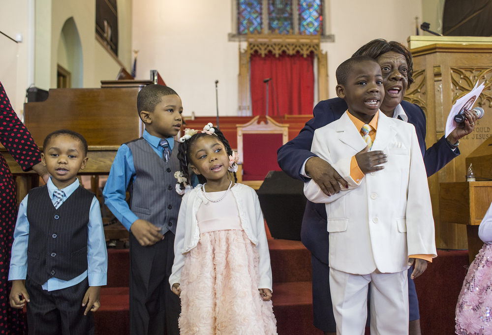 Beatrice Ford, right, performs a song with her Sunday School class at Second Canaan Missionary Baptist Church on Easter Sunday, April 20, 2014. Ford co-teaches the youngest children of the congregation, ages 2 to 6, every Sunday morning. Her church life is incredibly important to her and her family, and is a break from her typical work taking care of her husband, Hugh.