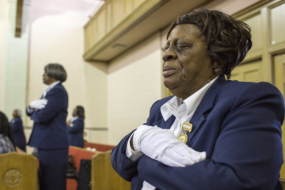 Beatrice Ford prays during the Easter Sunday service at Second Canaan Missionary Baptist Church on Detroit's east side, April 20, 2014. Ford volunteers as an usher at the church, helping people find seats, passing out programs and praying over members. Her church life is incredibly important to her and her family, and is a break from her typical work taking care of her husband, Hugh.