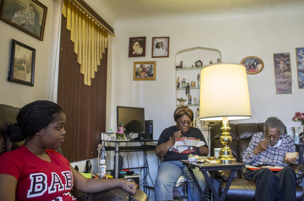 "Beatrice and Hugh Ford eat as their granddaughter Breann, 16, left, watches and plays on her phone Friday, April 18, 2014. Breann has lived with her grandparents for about two years when she and her sister and father moved in after her mother died. Breann says she and Beatrice Ford don't get along, admitting she's ""got a bad attitude."" Ford tries to help her son and granddaughters, but draws lines when they break rules. She told Breann's older sister she couldn't live in the house anymore after the teen stayed out all night with a young man. It wasn't the first time Beatrice had warned her to follow her rules, and Breann knows she is on the edge of being told to live elsewhere, too, if she doesn't ""straighten up."""