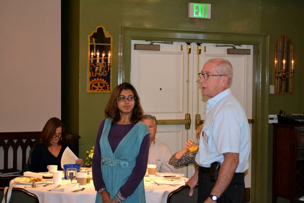 District Cultural Rotary Scholar, Aenia Amin is introduced by Jim Kennedy