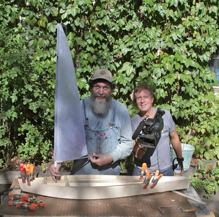 I built a sailboat to carry Maire Kent's ashes to the sea.  Here is a photo of Keith Famie and me in my backyard in Minneapolis.  The boat is finished and will launch in June 2014.