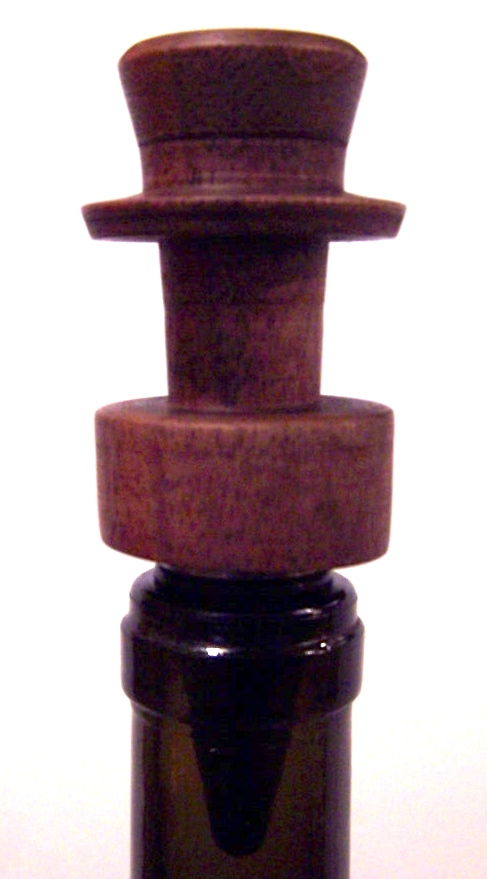 Very small pieces from the Quincy Street tree become bottle stoppers.  This is my first in the shape of a top hat.