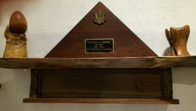 My father died when I was young.  He served in WWll and I designed this walnut box to hold his Military Flag.  The rustic walnut shelf is made from a tree that had grown too large for the space between a house and garage in Minneapolis.