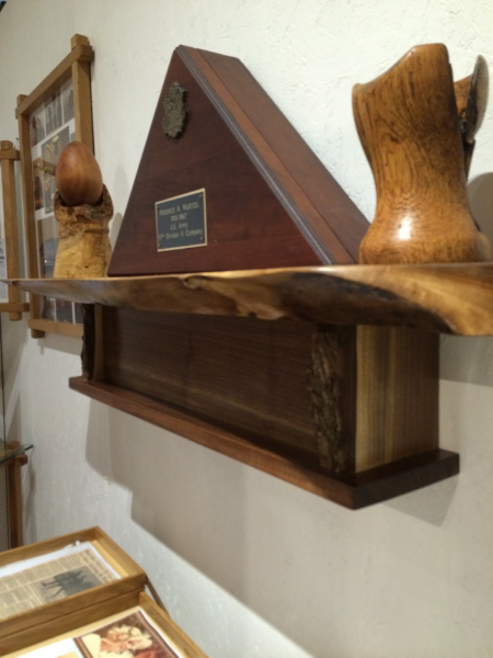 Side view of the Walnut mantle style shelf.   Notice the side brackets still have bark on them.    The piece on the right of the Flag Case is turned of oak with a lot of character.  The giant Cherry wood egg on stand won second place at the Minneapolis turner's meeting at Easter time.
