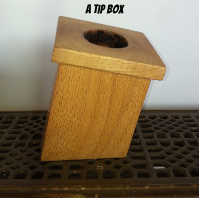 Tip box made of ash - tips go into the knot hole on top.