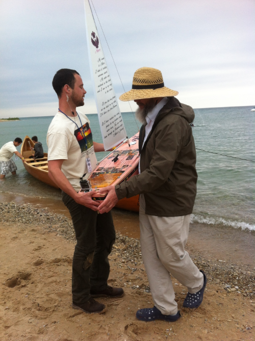 Handing the boat to a film crew member
