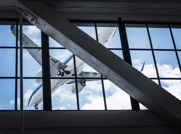 A Boeing jet on final approach at King County Municipal Airport (Boeing Field), as seen through Oxbow's gallery clerestory windows. Photo: James Lockwood