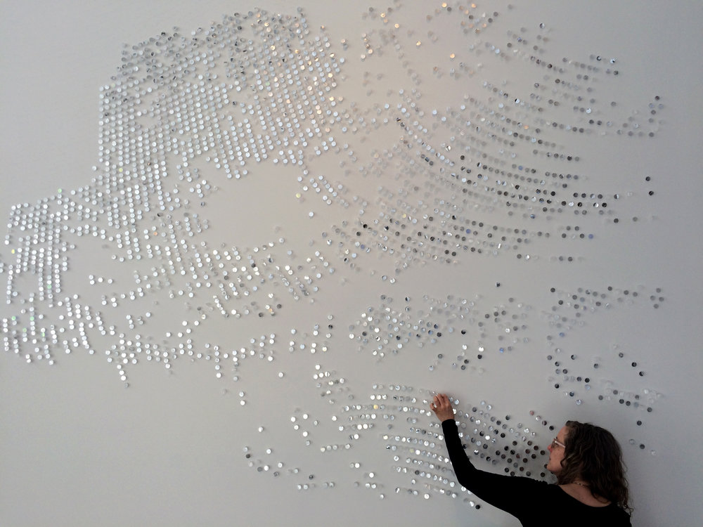 "Artist-in-residence Katy Stone working in Oxbow's gallery space on her site-specific work titled ""More Light""."