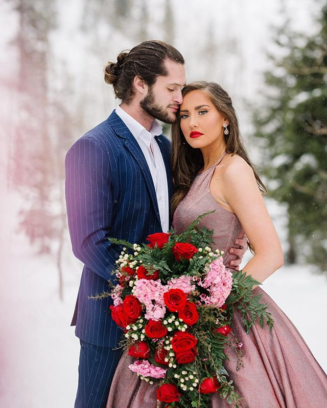 Holy smokes- @chanellealyssa planned the most amazing shoot! The models, flowers, dress and just everything was gorgeous! The light snow made it magical too. @danisherrie was a trooper in the cold! 👏🏻 Stylist: @chanellealyssa Models: @danisherrie and @daleguthrie Florist: @poppies.peonies.floral  Makeup: @merriemakeupartist Dress: @ypsilondresses.  #valentineshootaspengrove