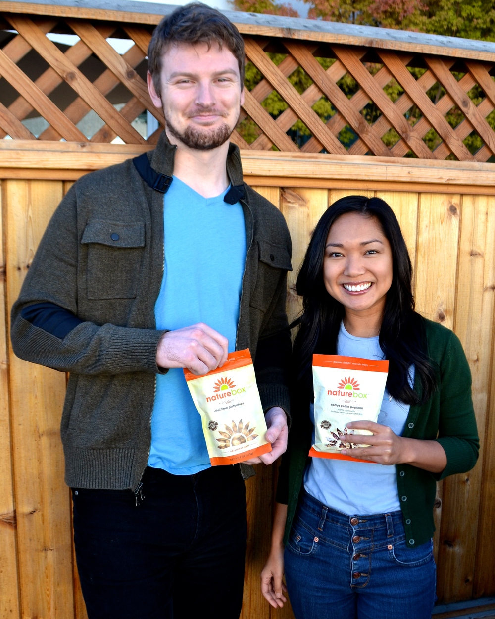 Zane and Amanda pose with their Chili Lime Pistachios and Coffee Kettle Popcorn - and they can't wait to dig in!
