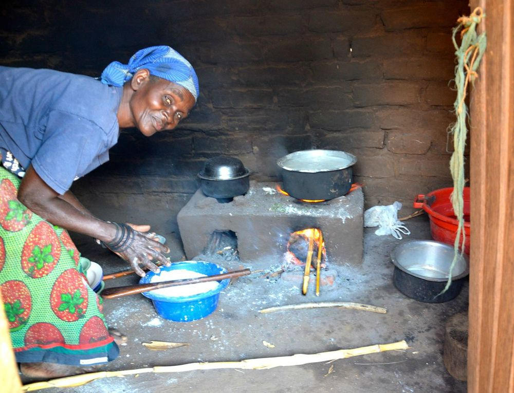 Grandma using the Fuel Saver Cookstove
