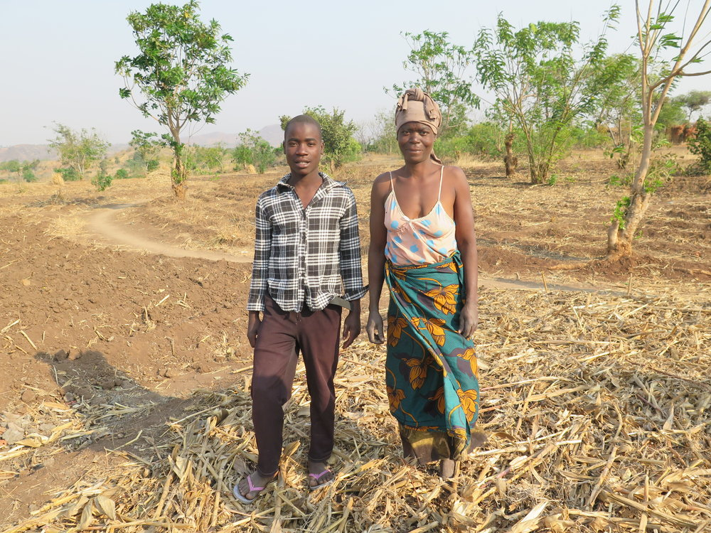 Adam and his mother on his sustainable plot.