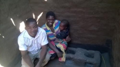 "This family is Saulus, Regina and year old Lyica. They have started coming to our training sessions, have built an ""energy saving stove"", and have used the new farming methods on a small section of their land.  Both improvements brought big rewards, so Saulus if going to use his new skills on all his land this year, with profits going towards iron sheeting for their leaky home."