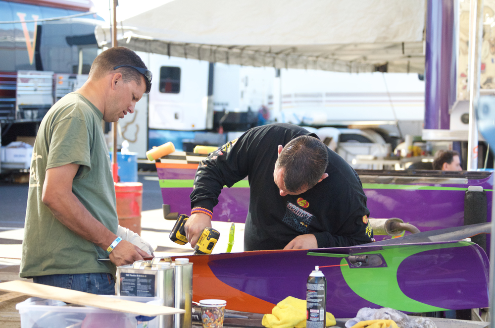 Crew members working on parts from Voodoo.  Reno Stead Airport, National Championship Air Races 2015