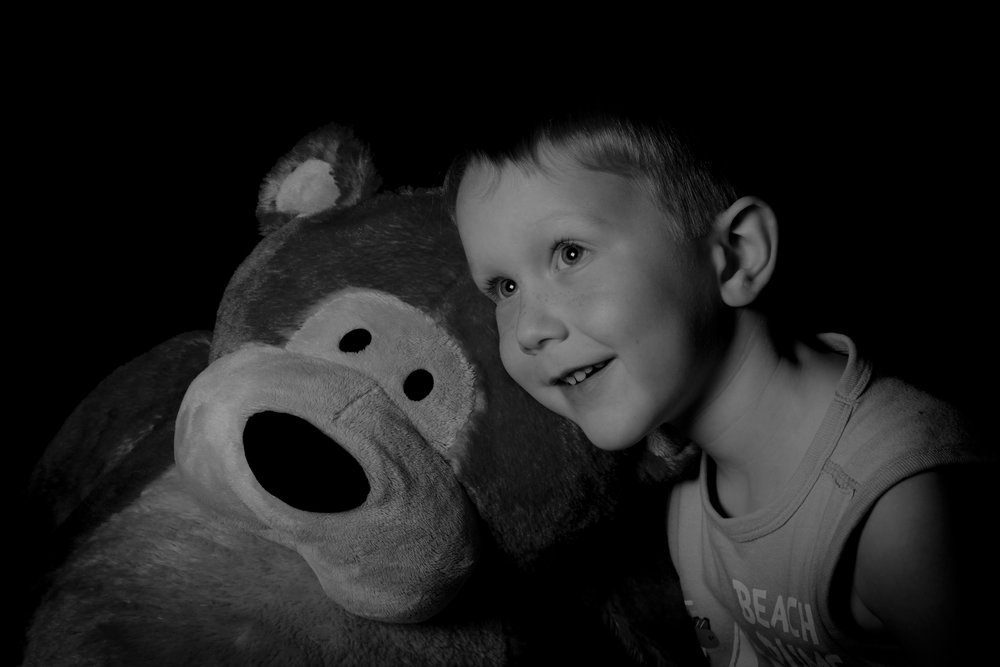 My Son.  January 2017, Fuji XT1, 56mm f1.2 lens, off camera flash in a soft-box with a black backdrop.