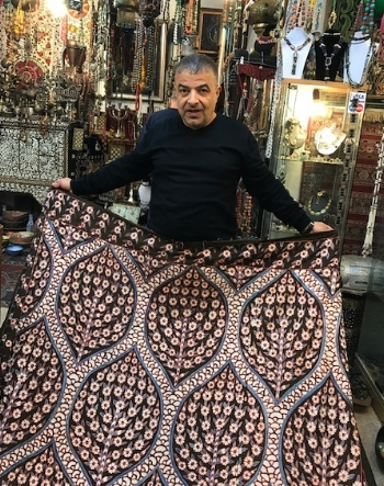 Omar displaying a gorgeous suzani.