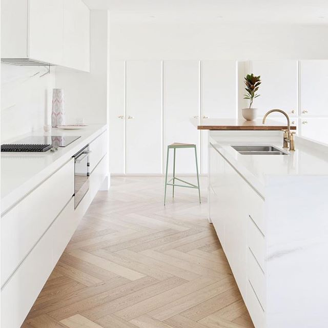 Beautiful minimalist kitchen, comprised of a soft herringbone floor and various marble elements | Toorak Residence by @heckerguthrie | Photo by @shannonmcgrath7 | #moderndesign #modernkitchen #heckerguthrie #minimalist #minimalistkitchen #kitcheninspiration #dreamhome #vancouver #luxurydesign #kitchendesignideas #whitekitchen #white #marble #designer #design #dreamhome #homedecor #homestyling #customhomes