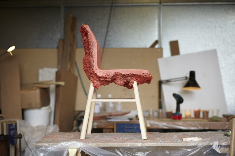 A freshly made red version of the 'Well Proven' chair on the work bench.  Photograph by Petr Krejci