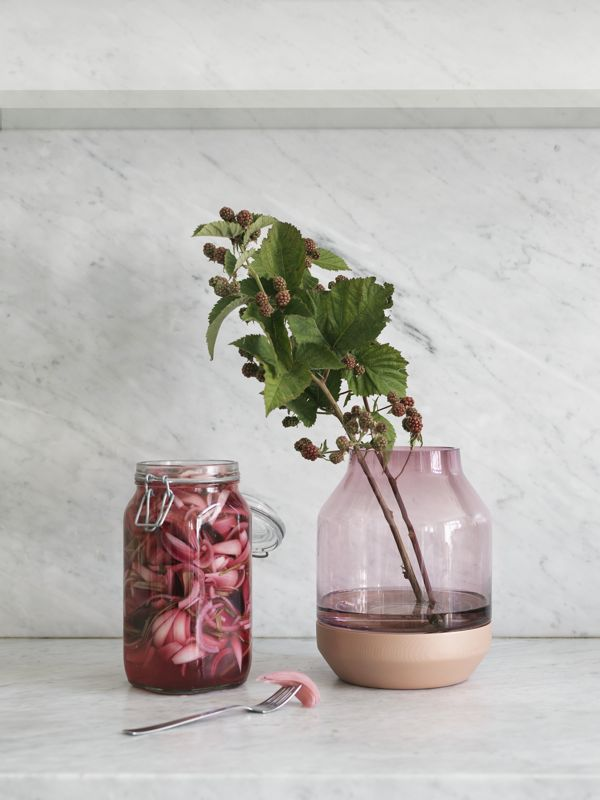 The new 'Elevated' vase by Thomas Bentzen for Muuto. The solid ash base comes with the choice of a grey, pink or green glass vase element.