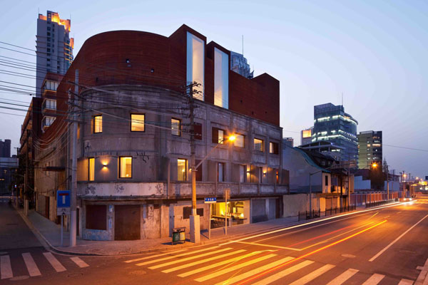 The Waterhouse Boutique Hotel in Shanghai was one of Neri & Hu's early projects It was a repurposing of a former army building with the addition of a dramatic Corten steel roof.
