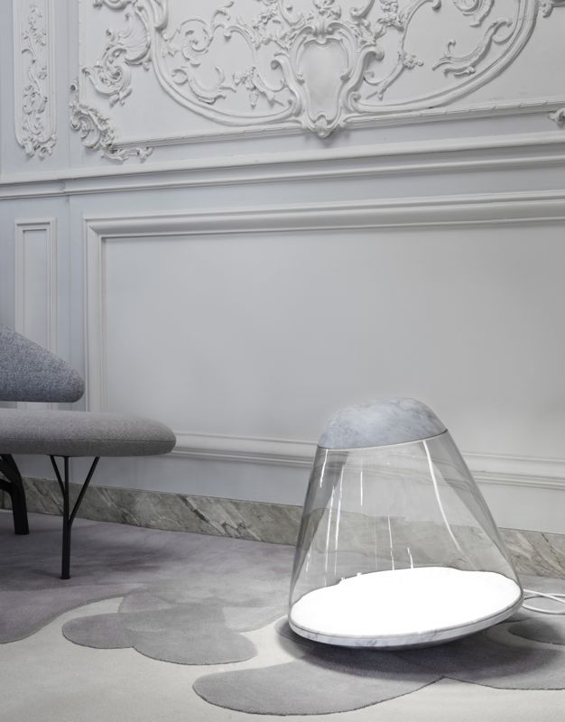 The Apollo light by Danny Yeffet & Lucie Koldova can be used on the floor or table and is offered in Black Marquina or Carrara marble. The 'Anenome' rug is by Francois Dumas and the 'Borghese' sofa by Noe Duchaufour Lawrance.