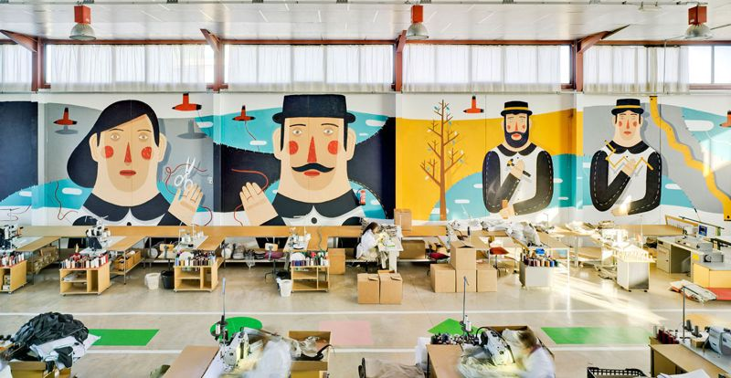 The cutting and sewing lines in Sancal's factory now have a much brighter and happier outlook. The 10 metre high and 40 metre long mural by Agostino Iacurci was commissioned to coincide with the Spanish brand's 40th anniversary in late 2013.