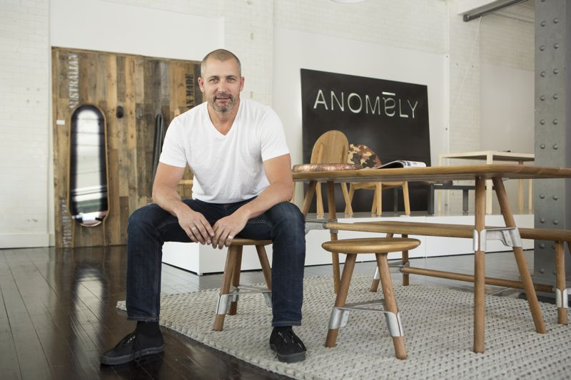 The founder of Axolotl and co-founder of Anomaly, Kris Torma at the Oxford st Sydney pop-up shop launch of the brand last October. The brand includes work by some of Australia's best young designers such as Adam Cornish and David Knott, whose 'Elements'  table, bench and stool designs are in the foreground. Some of David Caon's designs can be seen in the background.