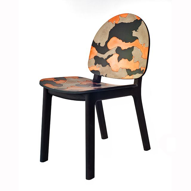 David Caon's 'Ghillie' chair in the 'Camo' form that features a concrete and brass camouflage-style surface finish.