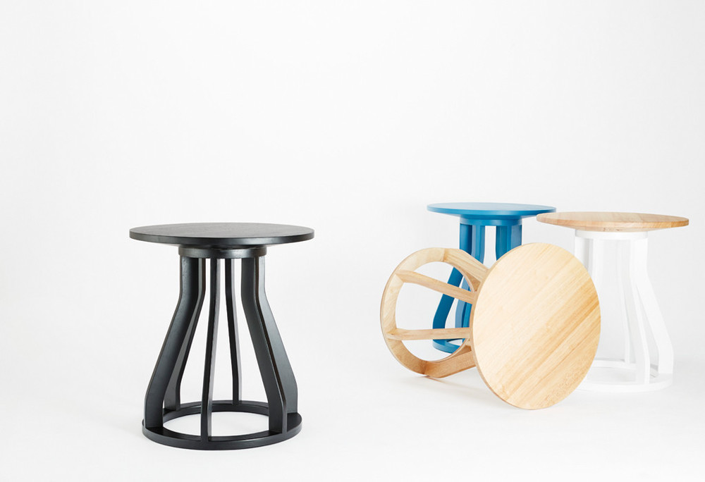 The 'Spool' stool by Jon Goulder for Dessein Furniture comes in a range of colours or in natural timber. The stool also forms the basis for a bench with the addition of a timber top machined with circles to accommodate the stool as a base.