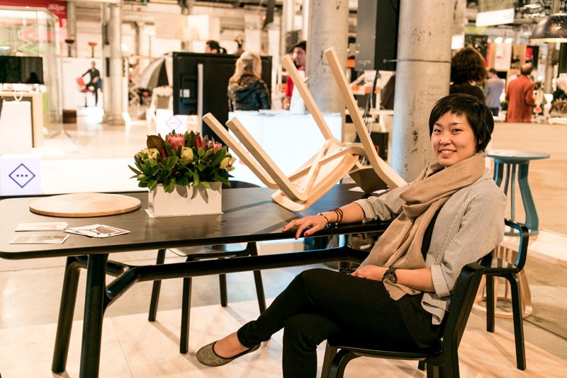 Founder of Dessein Furniture, Michele Chow at the brand's Sydney launch at InDesign in August 2013. Michele is seated at Justin Hutchinson's table with Adam Goodrum's 'Para' chair and Goulder's 'Spool' stool in the background.
