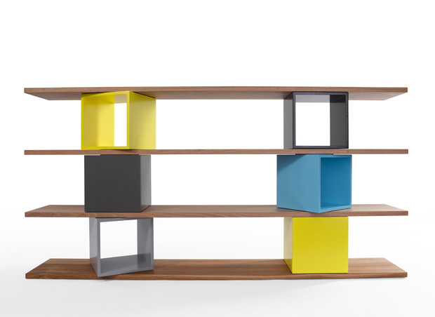 The 'Cubo' modular shelving system by Alex Lotersztain is a combination of lacquered cubes in any of six colours and Tasmanian oak shelves. The boxes can be open or with hinged doors. In the vertical storage form without shelves, it can  be stacked 5 cubes high.